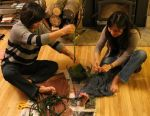 Jan (Kim's mom) and Kim making ti leaf lei for the CD release celebration